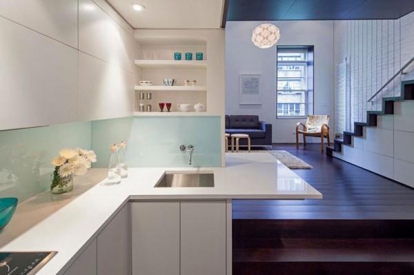 How to Decorate a Small Apartment in New York apartment in new york How to Decorate a Small Apartment in New York Manhattan Micro Loft white downlit kitchen